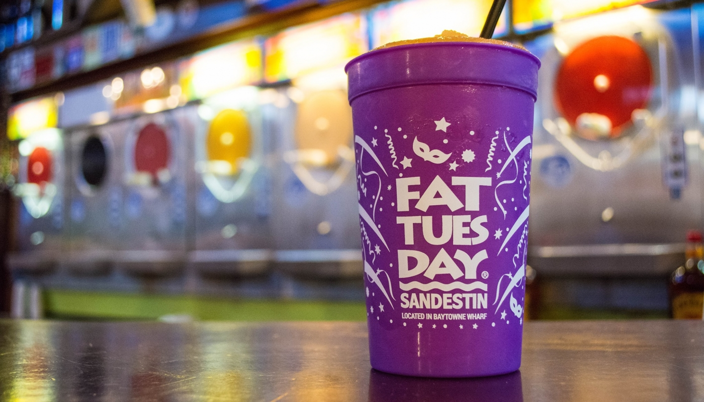 Fat Tuesday purple cup sitting on a bar