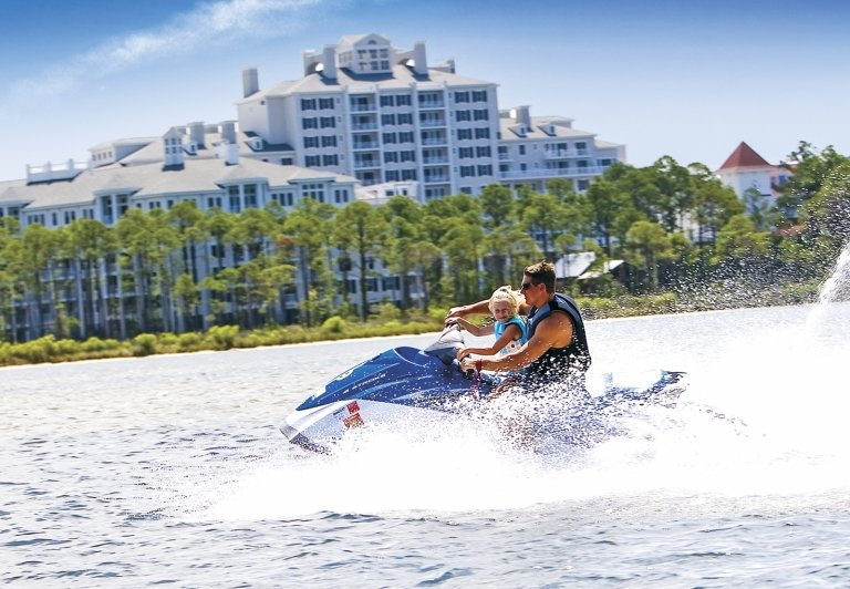 man and son on a sea-doo
