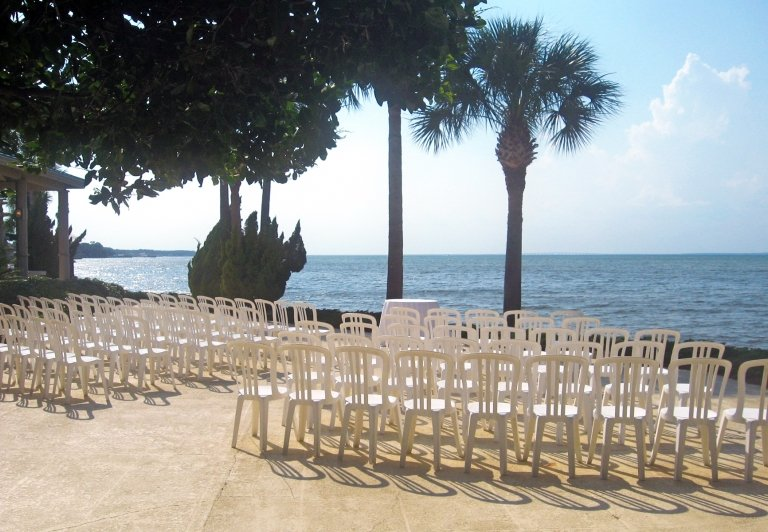 Bayview Terrace set up for a wedding with rows of white chairs