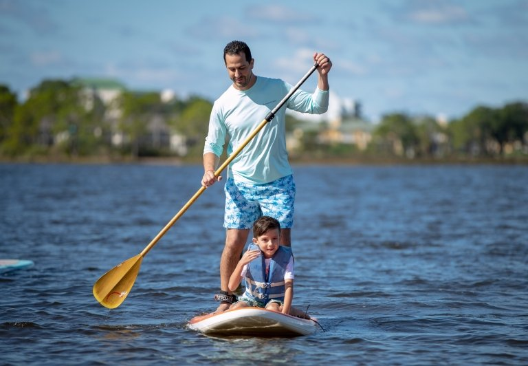Father and son paddlebaording