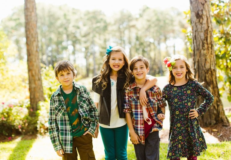 Four children dressed in clothing from coconut kidz at Sandestin Golf and Beach Resort