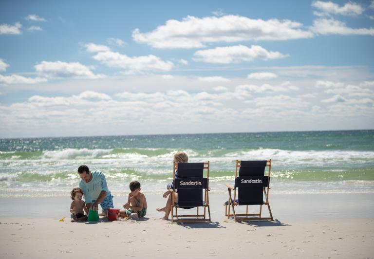 family on the beach with beach chairs