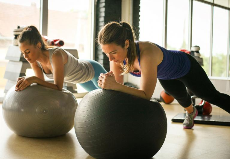 Women doing planks on a stability ball