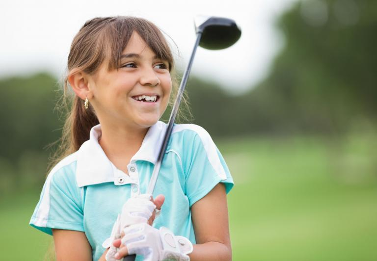 young girl with a golf club