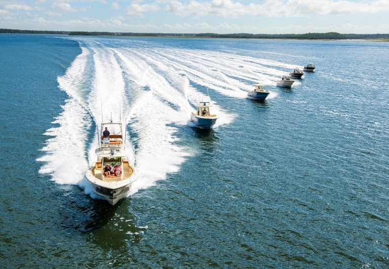 six speed boats racing in the water