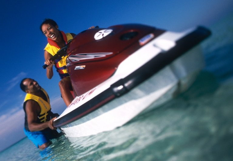 a couple getting on a waverunner