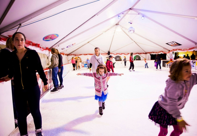 A family Ice Skating at Sandestin Golf and Beach Resort