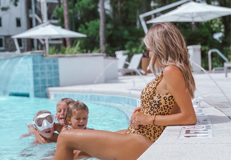 Jessica Fay lounging at the pool with children
