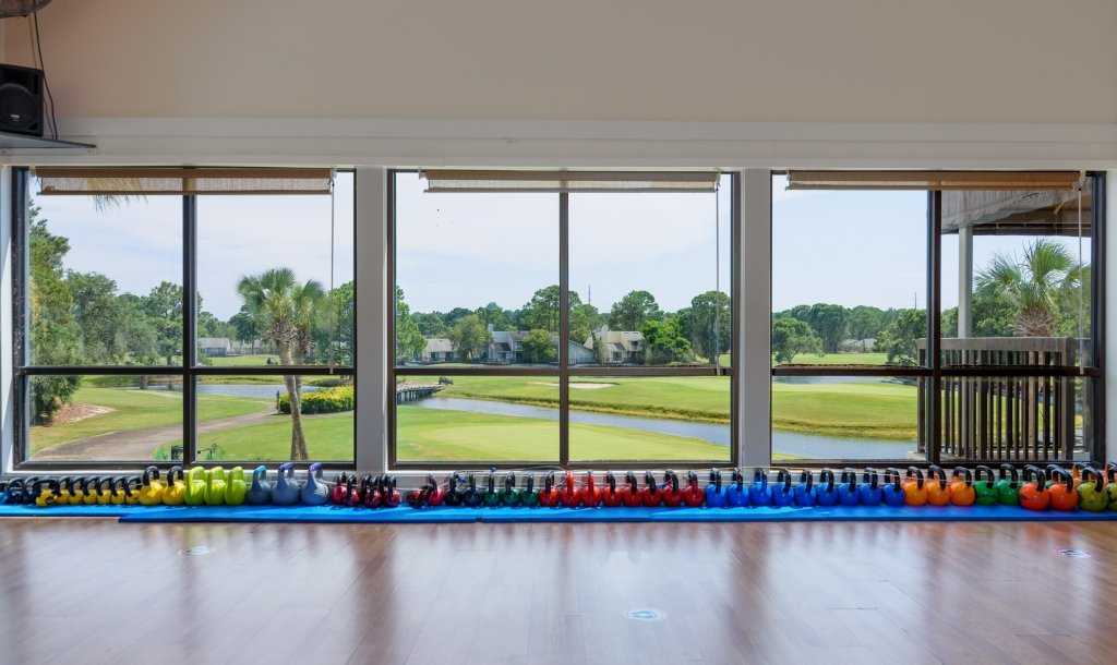 weights in front of a window overlooking the golf course