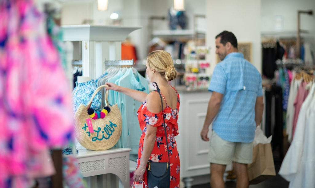 woman looking at a handbag that is for sale at Barefoot Princess