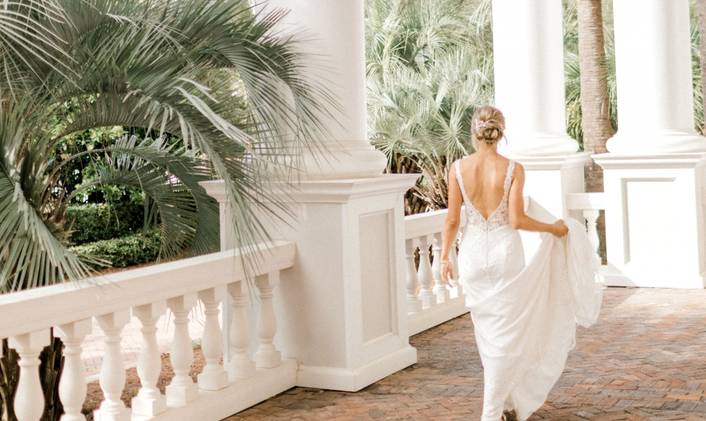 bride walking on an outside patio at Sandestin Golf and Beach Resort.