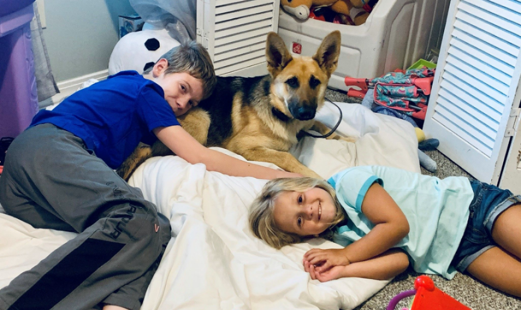 Remi Lewis and his sister with their dog, Willow