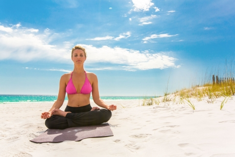 woman doing yoga on the Sandestin beach
