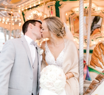 bride and groom kissing on a carousel