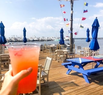a frozen drink with the patio of Marina Bar & Grill in the background