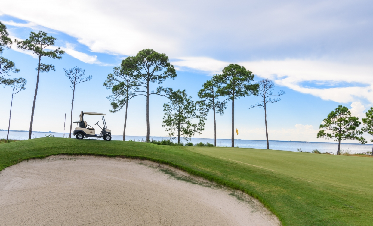 sand trap and golf cart at sandestin golf and beach resort golf course