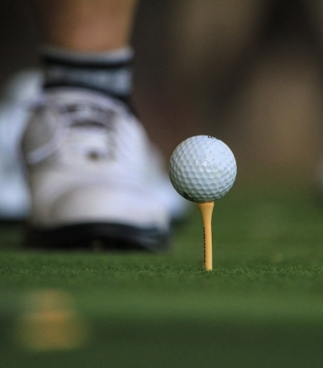 close up of a golf ball on a golf tee
